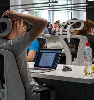 Employees sat a desks working on computers in an office