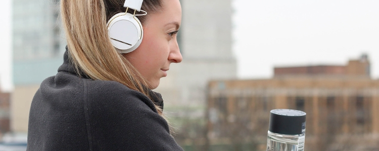 Lady out for a jog stops to listen to something captivating